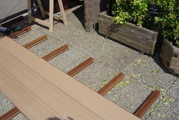 Am nagement de terrasses pose de palissades et abris de for Poser du carrelage sur une terrasse